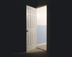 Door opening into dark room