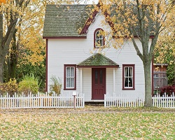 Old white house with white picket fence