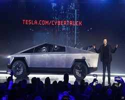 Damaged Tesla Cybertruck on stage with Elon Musk