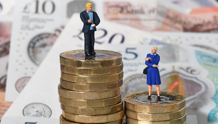 Male and female figures on cash