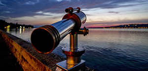 telescope looking out over a lake