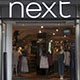 Next Shares Fall After Results