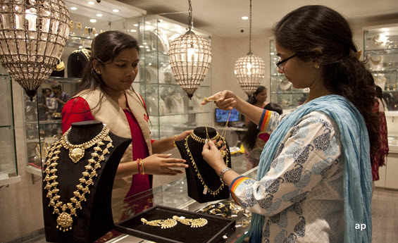 Indian women buying gold jewellery