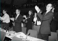 """Photograph of representatives applauding as the Kyoto Protocol is adopted"""