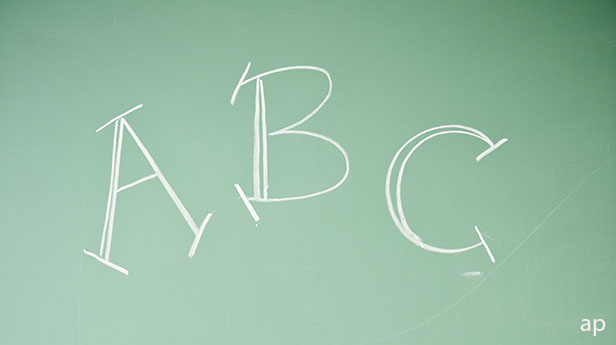 A B C written on a chalk board