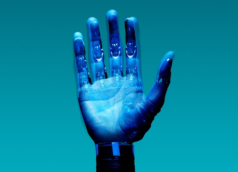 Blue robotic prosthetic hand raised 8