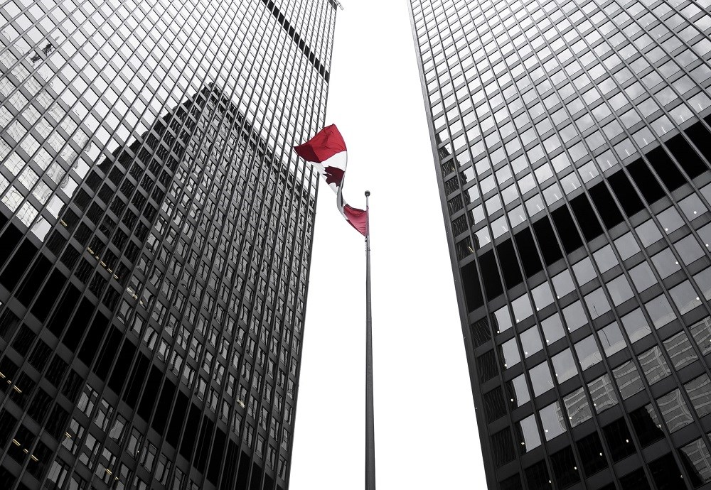 Tall buildings with Canadian flag
