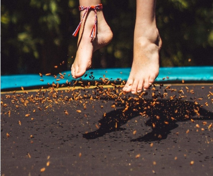 Feet above a trampoline