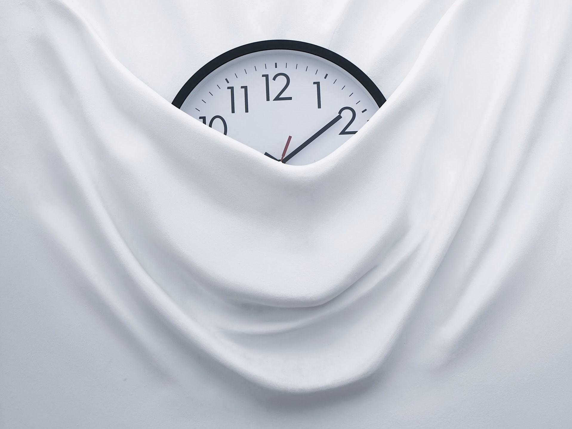 Clock Behind Blanket
