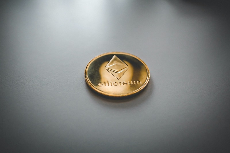 Ethereum coin on grey background