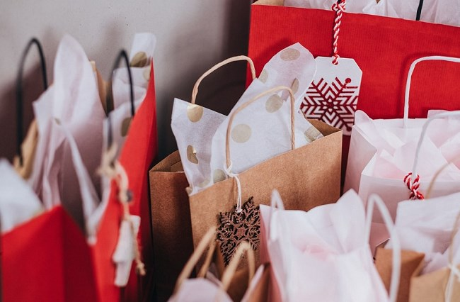 Red and brown gift bags with Christmas tags