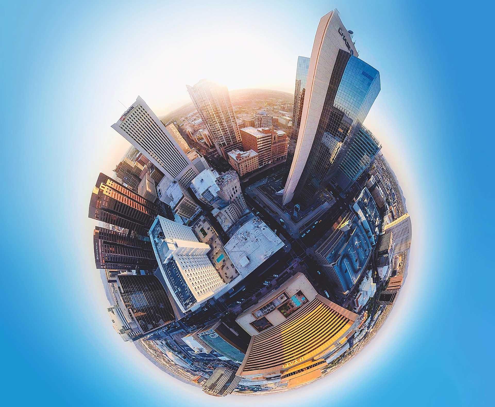 Photo artistique d'un globe avec des gratte-ciels
