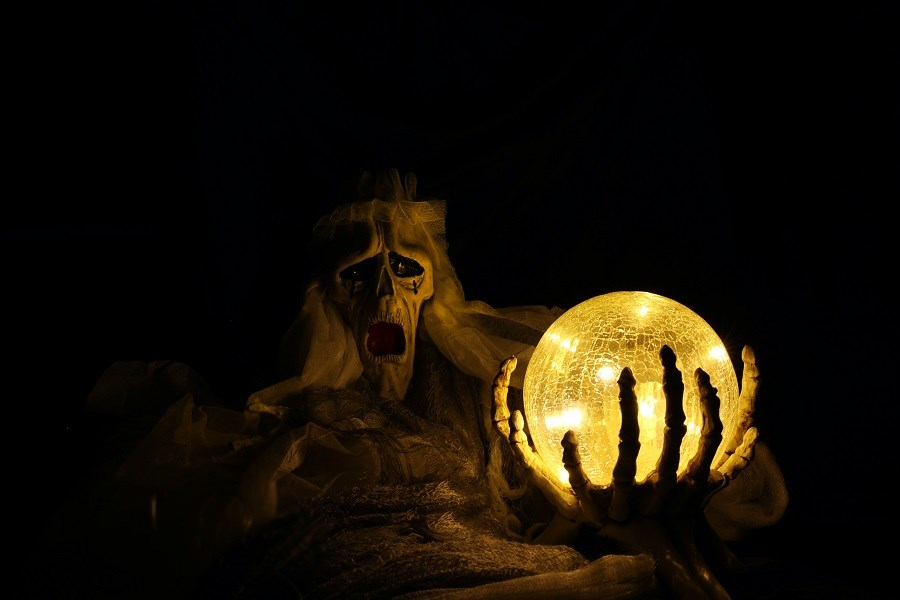 Monster holding globe