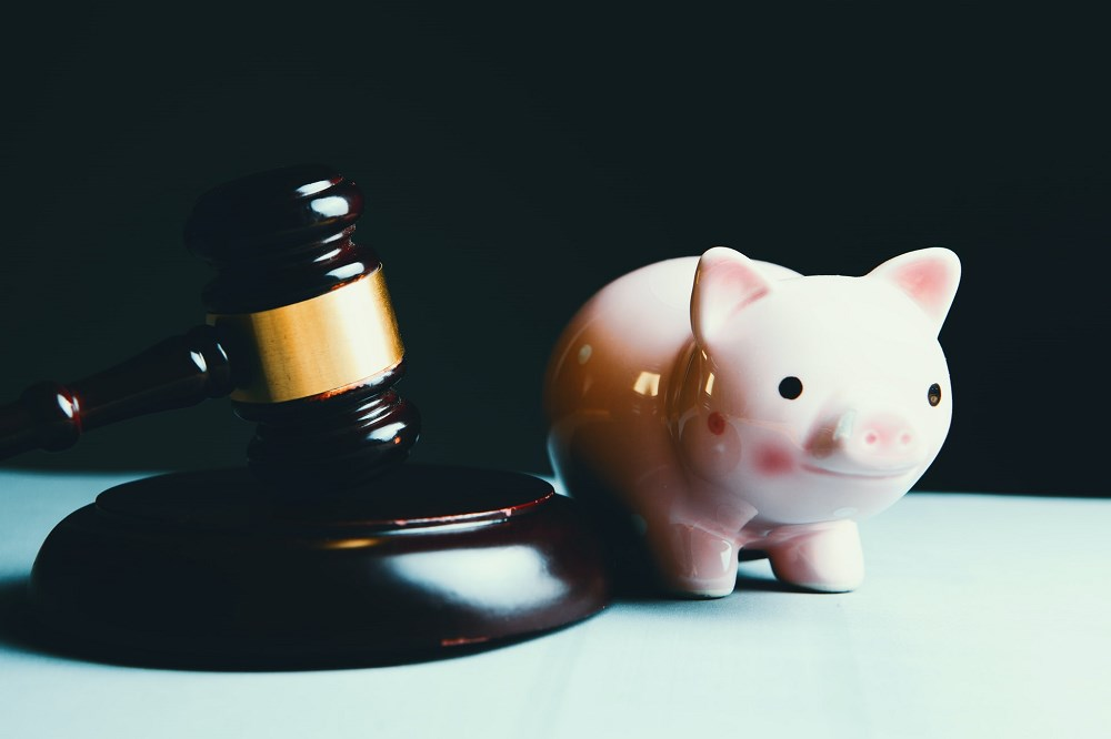 Judge's gavel and piggy bank