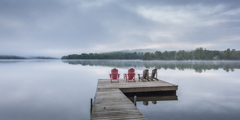 Lawn chairs on lake