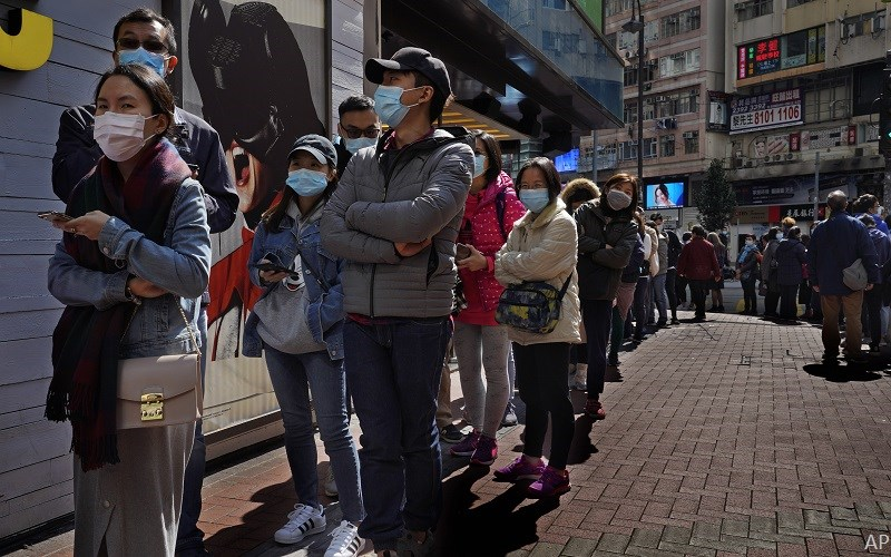 Line-up in China of people wearing face masks