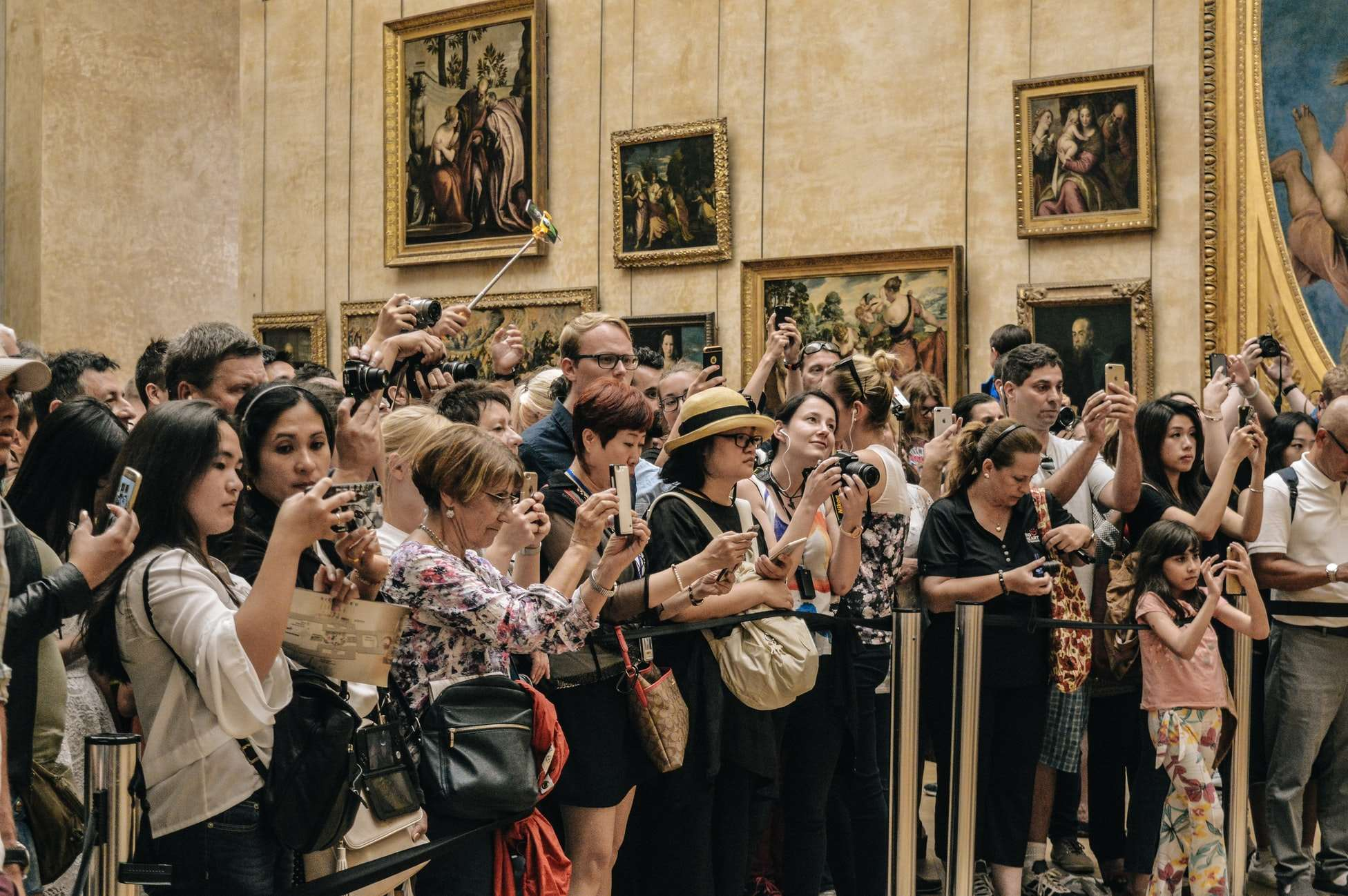 Louvre visitors with phones