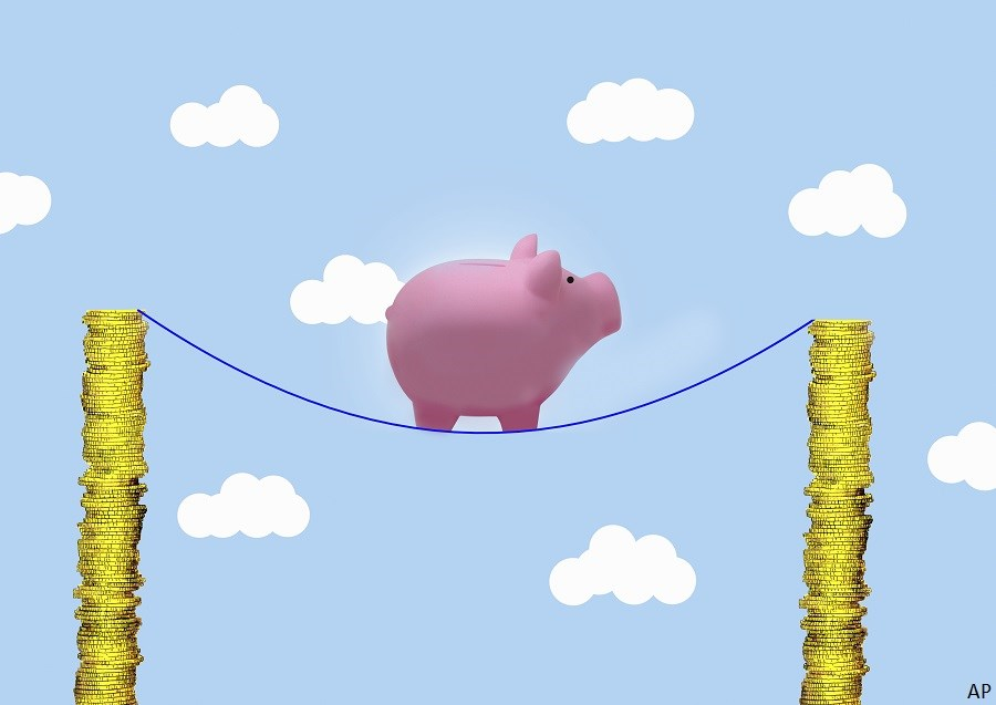 piggy bank on tightrope