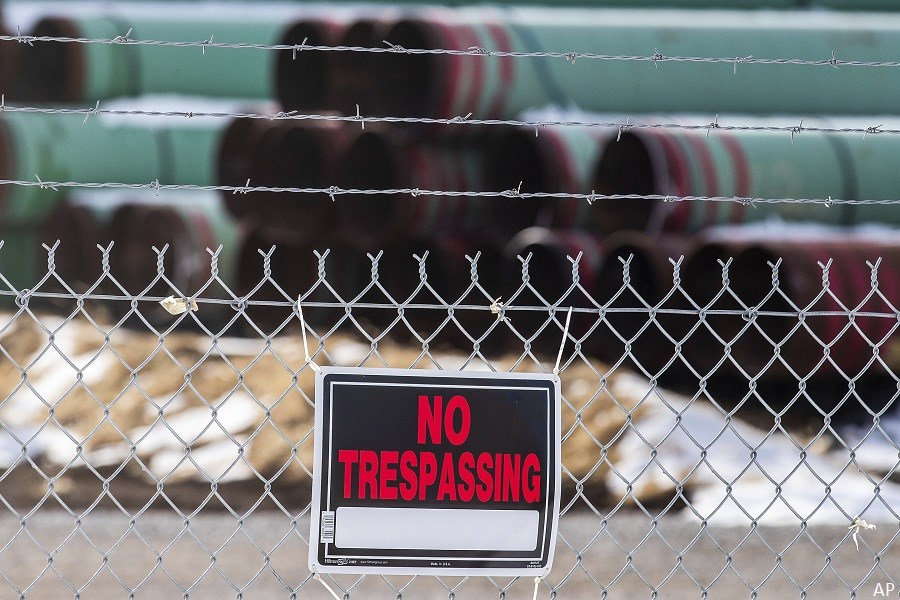 Pipelines with no trespassing sign