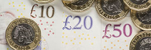 Pound coins and notes 300 by 100