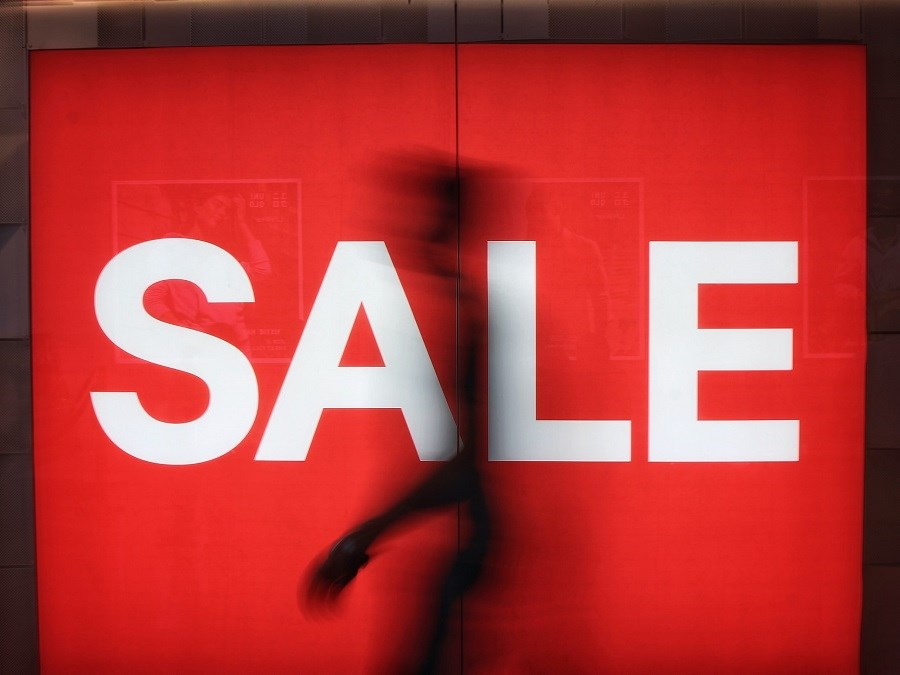 Red sale sign in a store window