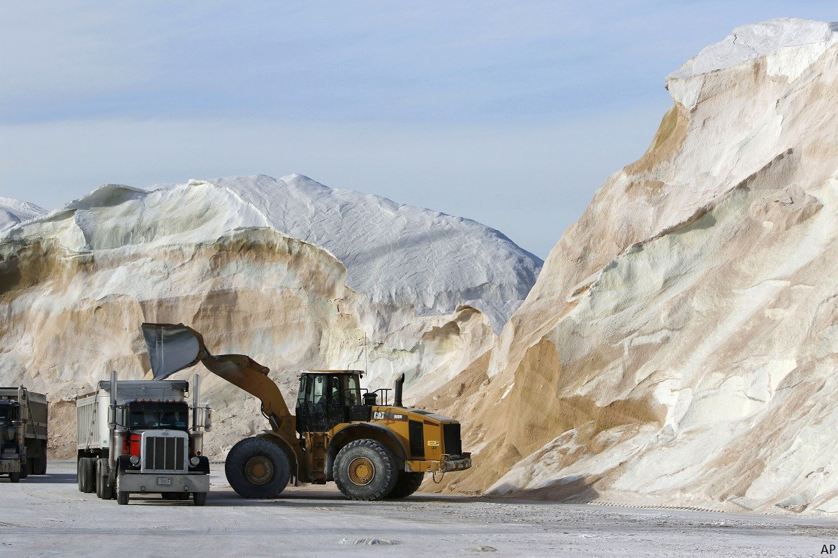 Large pile of salt being loaded onto a truck