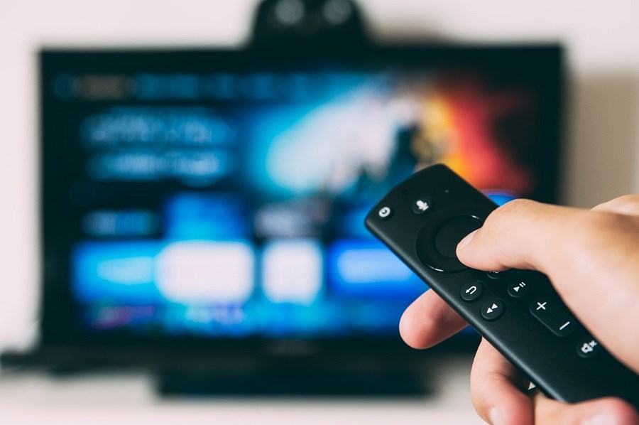 Remote control in front of TV