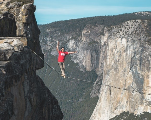 Man walking on tightrope