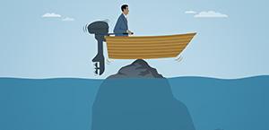man on boat stranded on a rock