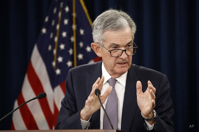 Fed cuts rates again