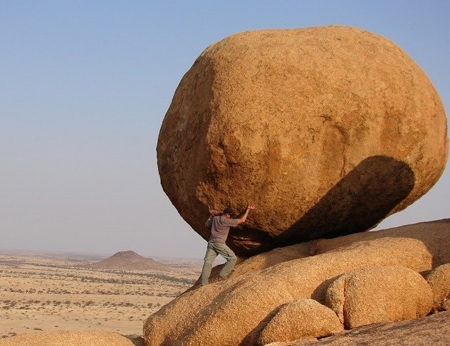 Man pushing boulder