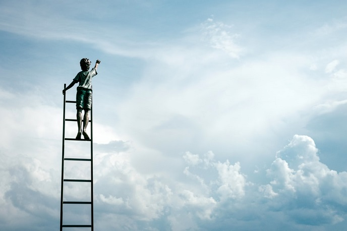 Boy climbing ladder to sky