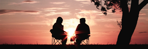 Couple sitting at sunset