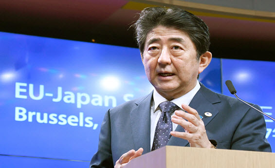 Japan Shinzo Abe Abenomics record dividends yield stock income