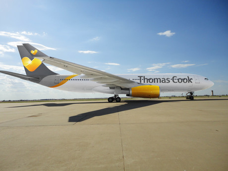 Thomas Cook group profits warning dividend cut equity stock travel