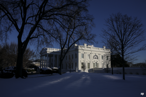 white house in winter US government shutdown investment markets Donald Trump